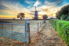 Most mills are located along waterways for pumping or easy transporting. This mill De Windhond (Greyhound) in Soest (Netherlands) is situated in the midst of farmland and was used to grind grain into flour.