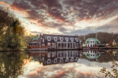 Sunset at new houses along the river Vecht