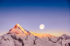 A lucky meeting of the sunrise and the moon at the Rhone Valley (Switzerland). Just a few days after the bloodmoon night.